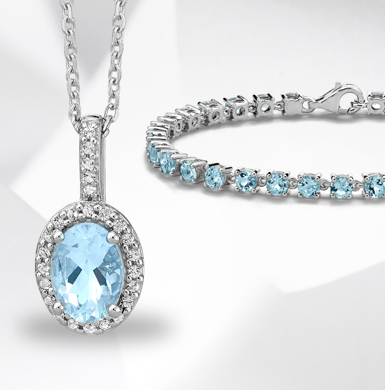 Image of aquamarine necklace and bracelet set in white gold on a grey and white textured background.
