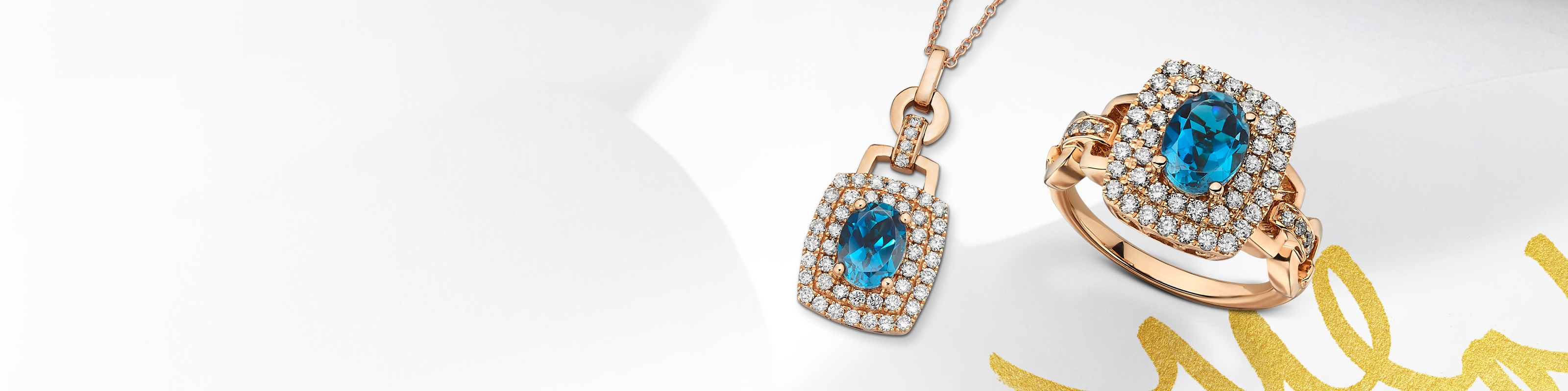 Blue topaz ring and necklace with diamond halos set in rose gold. Shop all blue topaz jewelry at Jared.