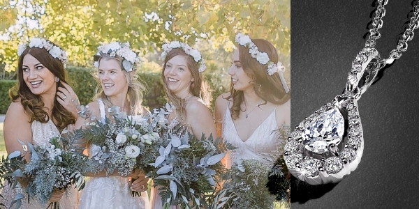 Group of bridesmaids holding bouquets of flowers and wearing flower crowns next to a diamond necklace on a black textured background.