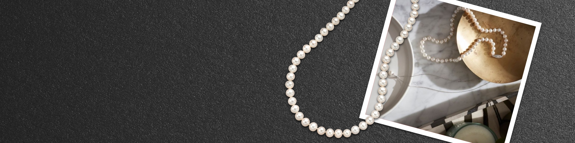 Pearl necklace on a countertop next to a bowl. Shop Brilliant Moments pearls.
