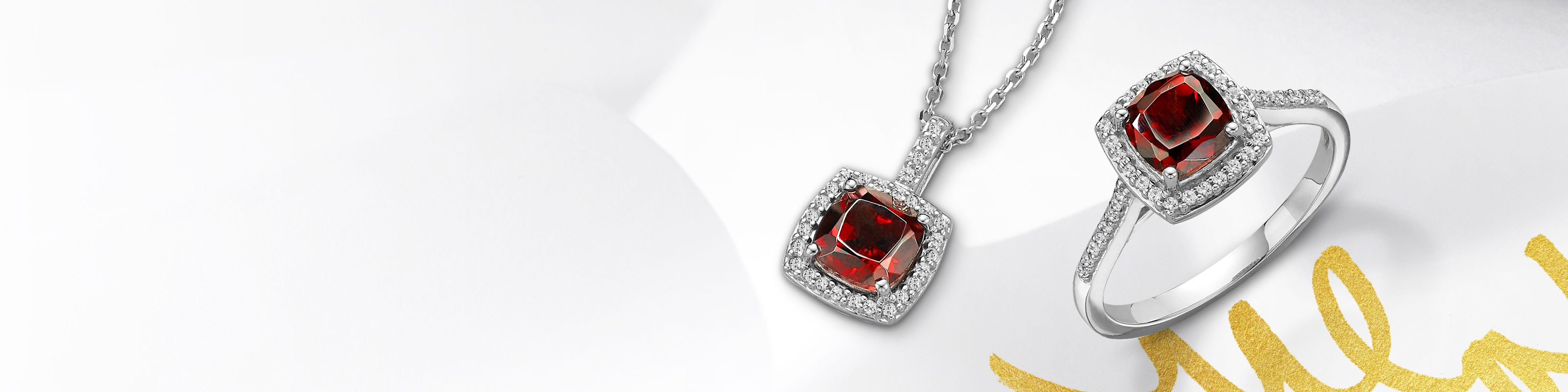 Garnet ring and necklace set in white gold. Shop all garnet jewelry at Jared.