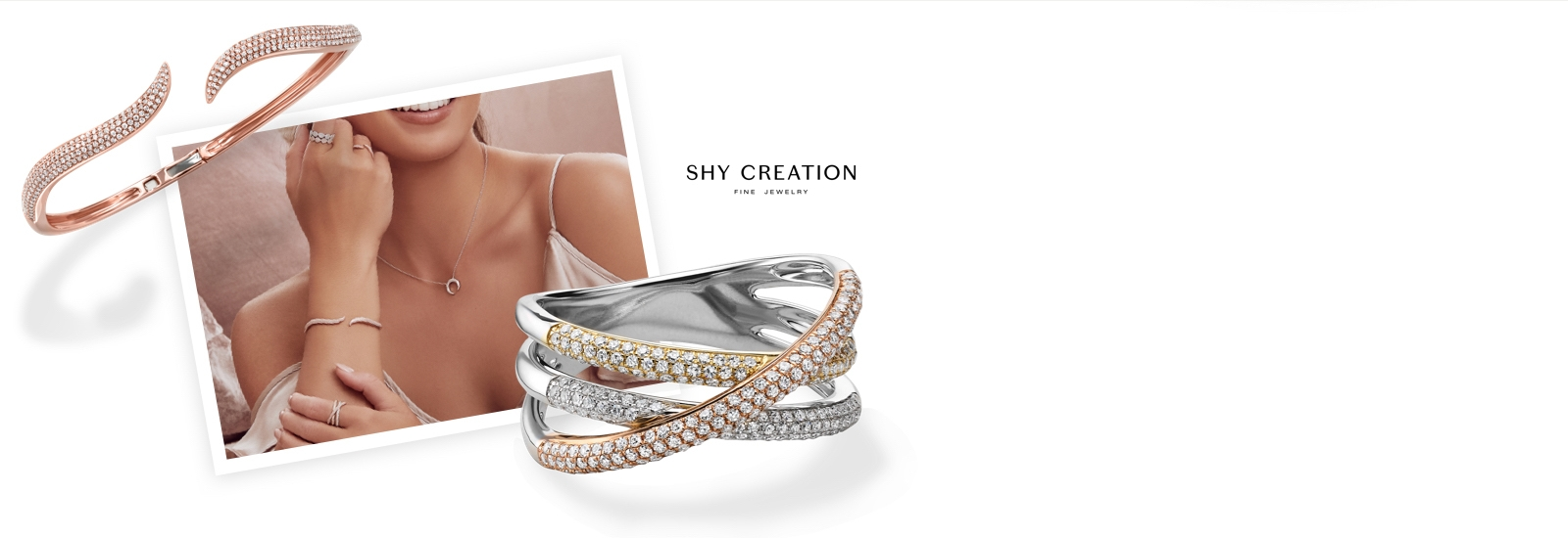 Woman wearing diamond Shy Creation rings, bracelets and necklace, featuring a rose gold and diamond bracelet and multi-tone gold ring. Shop Shy Creation jewelry at Jared.