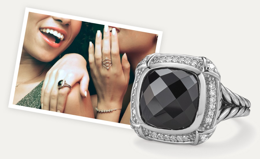 Woman wearing black onyx Studio Suite ring with diamond halo, featuring the same ring up close. Shop Studio Suite at Jared.
