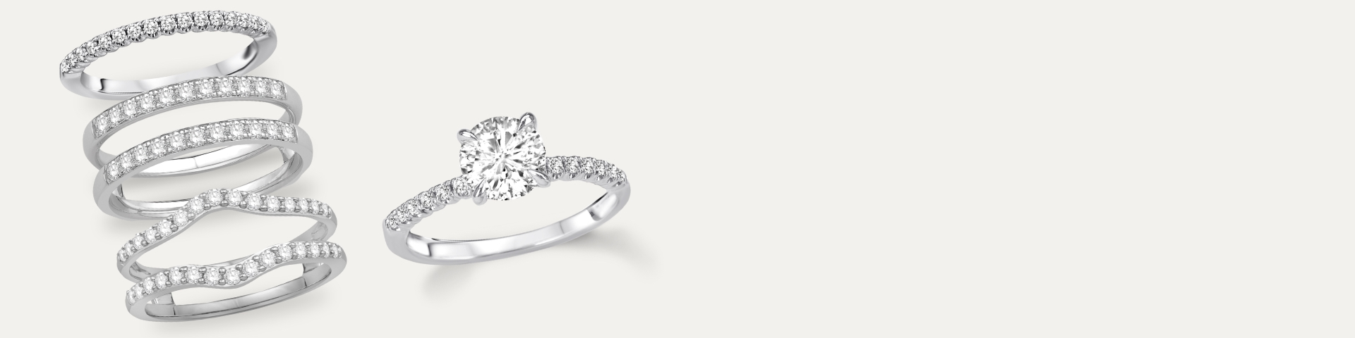 white gold diamond engagement ring and wedding bands against white background