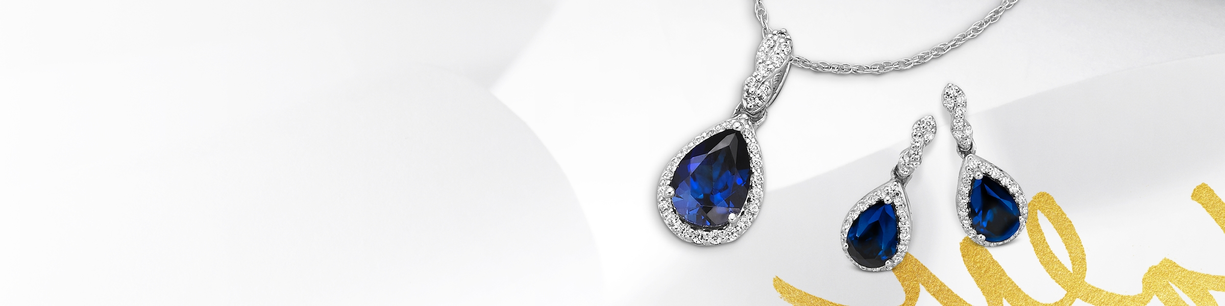 Sapphire earrings and necklace set in white gold. Shop all sapphire jewelry at Jared.