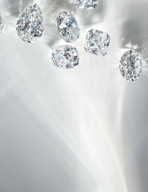 Loose diamonds on black background