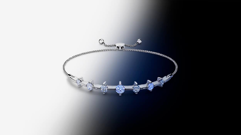 A Jared brand bracelet shown under both white and ultraviolet light