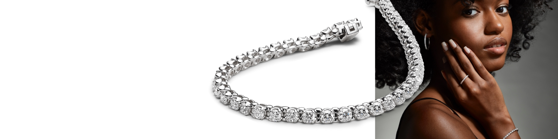 Woman wearing white gold and diamond tennis bracelet, hoop earrings, and ring. Shop all new jewelry arrivals at Jared.