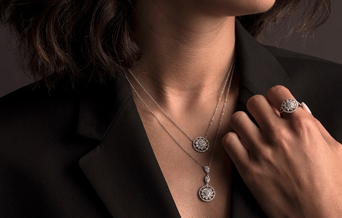 Woman wearing multiple length Shy Creation White gold necklaces