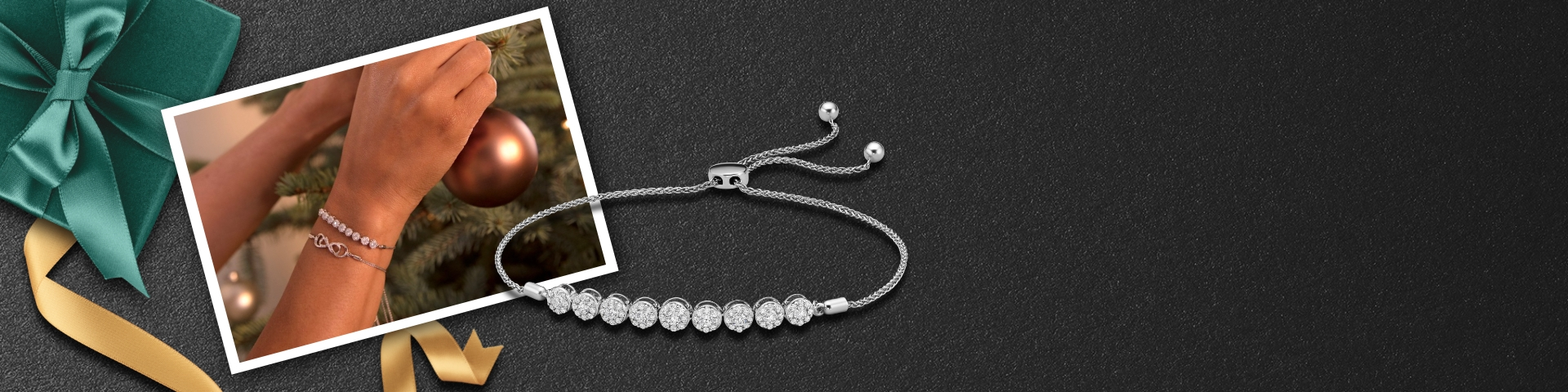 Image of a woman's wrist wearing two diamond bolo bracelets while putting an ornament on a Christmas tree.