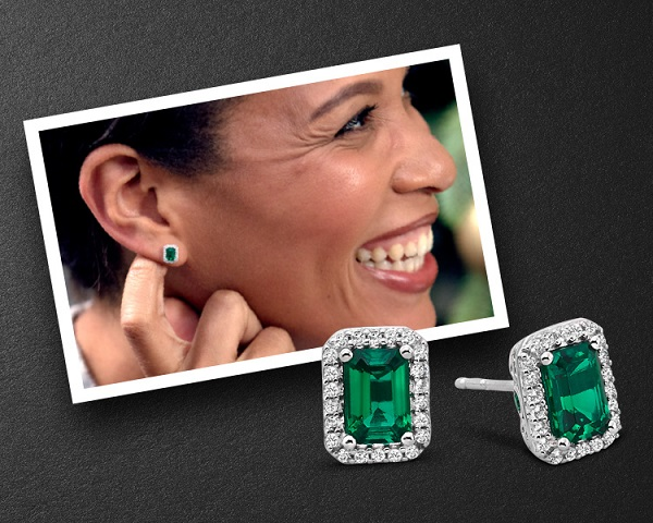 Woman wearing emerald earrings from Jared. Shop all women's gemstone earrings.