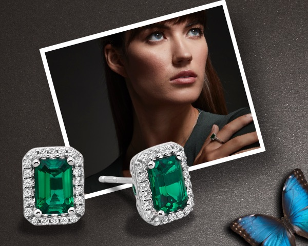 Picture of a woman wearing emerald green necklace and ring next to an image of similar earrings with diamond halo on a grey textured background.