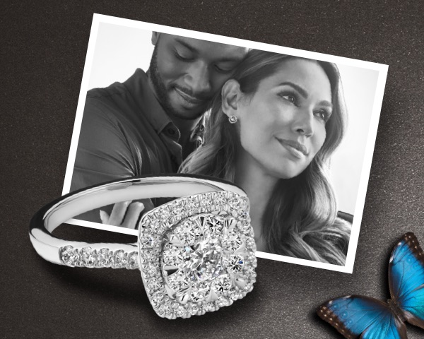 Cluster round-cut diamond on black background, couple embracing