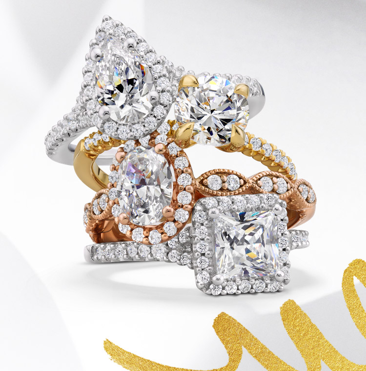 a stack of engagement rings rests on a white patterned background