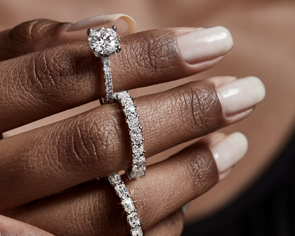 woman's hand with engagement and wedding rings